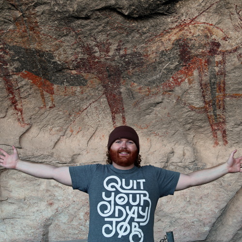 Lifelike, right? Just kidding, that's Josh. Above him is one of the most impressive pictographs, possibly depicting a shaman