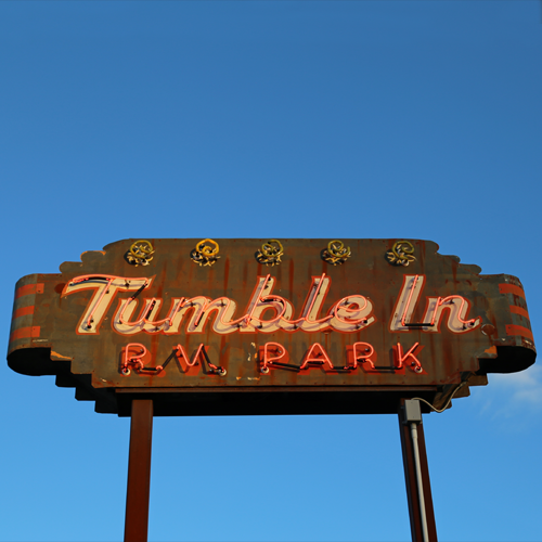 The neon tumbleweed on the sign actually tumbles