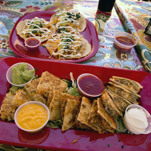 Beef, chicken and carne adovada quesadillas and tacos