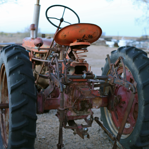 Tractors keep each site level with weekly raking