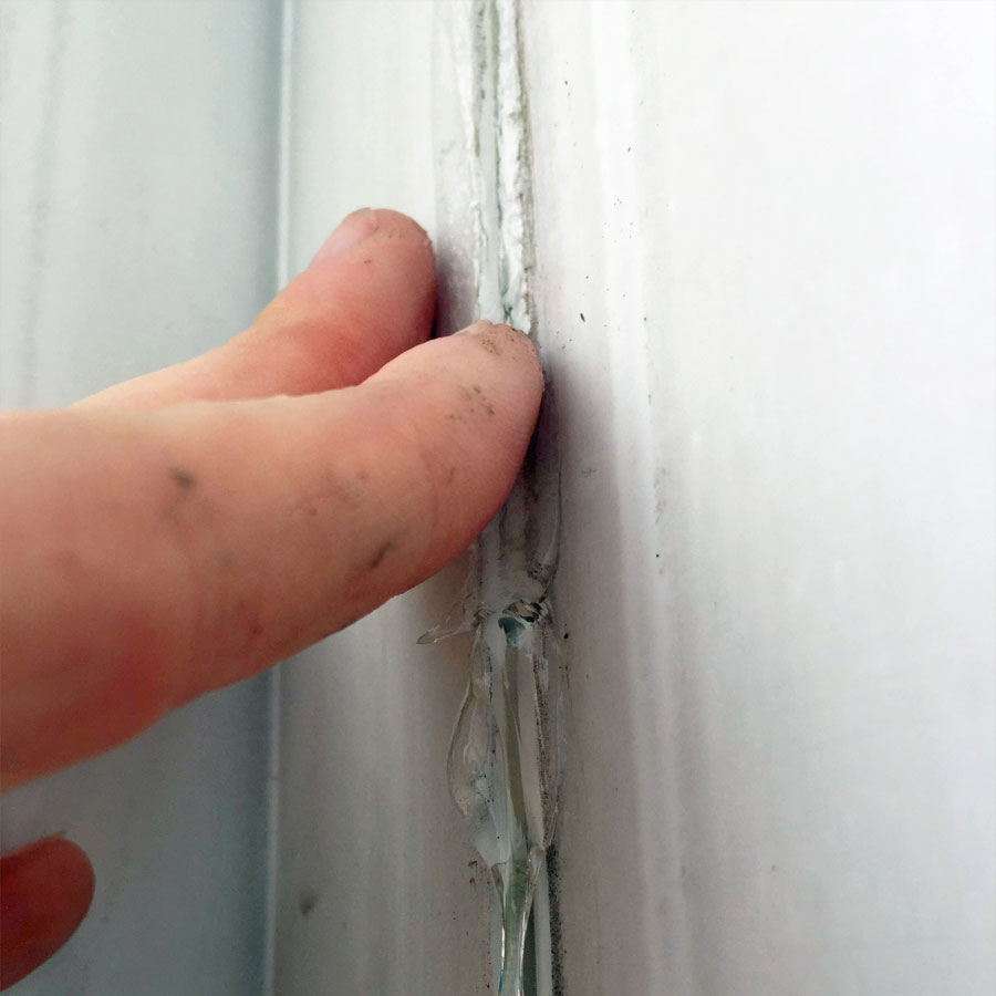 Smooth Caulk on RV with Fingers
